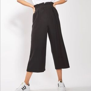 Topshop ruffle waist black cropped trousers